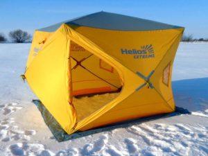 Желтая рыболовная зимняя палатка HELIOS Куб 1.5х1.5, установленная на озере